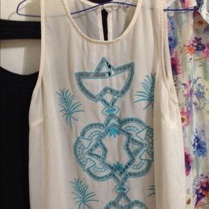 All clothing buy one get one free! Boho top pretty